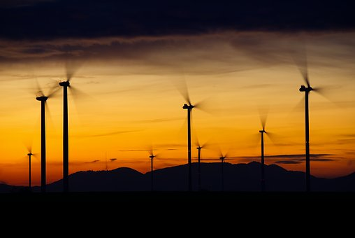 Picture of windmills at sunset.
